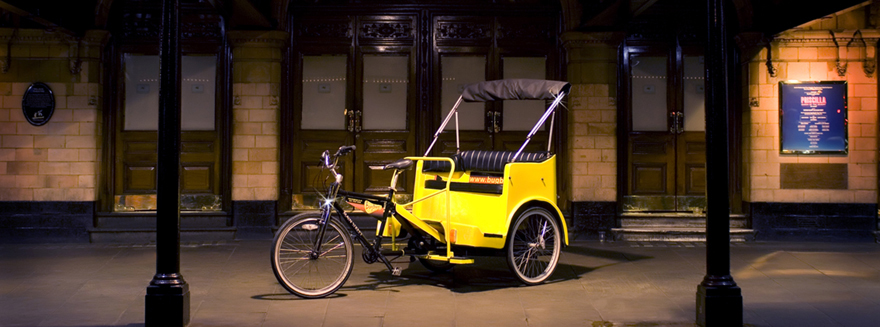 A Bugbugs rickshaw under the spotlight, outside a west end theatre at night