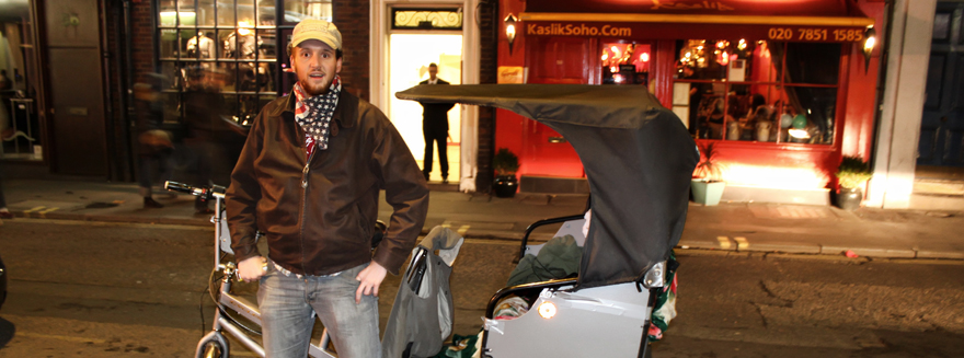 A Bugbugs rider posing with pedicab during the evening shift at work in Soho, Central London